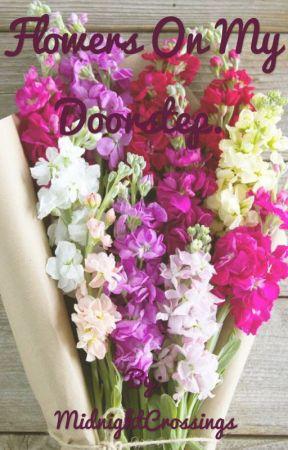 Flowers on my doorstep by MidnightCrossings