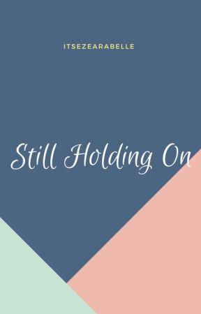 Still Holding On by itsezearabelle
