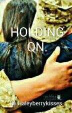 Holding on by Haleyberrykisses
