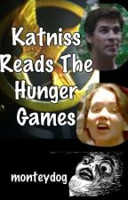 Katniss reads the Hunger Games by monteydog