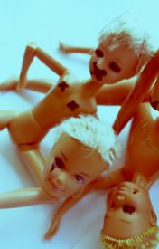 Broken Barbies by HiddenSkull