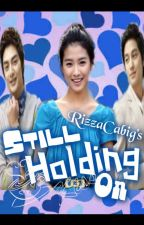 Still Holding On (A love story of a lifetime) by RizzaCabig
