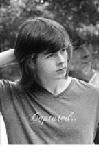 Captured (A Chandler Riggs love story) by xxteddybearxx12