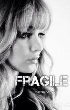 Fragile by THGtrilogyfan