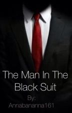 The Man In The Black Suit by WinterRose1404