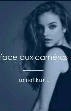 Face Aux Caméras  by urnotkurt