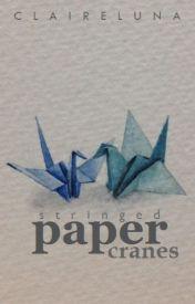 Stringed Paper Cranes by PepperPoet
