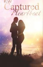 Captured-Heartbeat*slow* by Angora77