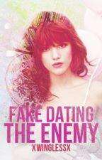 Fake Dating The Enemy by xWinglessx