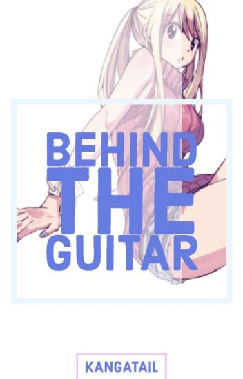 Behind the guitar