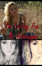 I'm Falling For My Kidnapper by lexi245