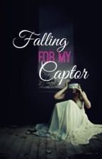 Falling For My Captor by JacqTheWriter